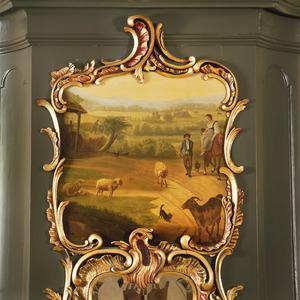 Landschap met grazend vee en diverse figuren