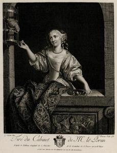 Jonge vrouw in een venster, voert een papegaai