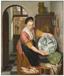 Dienstmeisje in een keuken