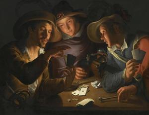 Drie jong mannen bij het kaartspel
