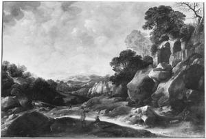 Zuidelijk landschap met herders in een rotsachtig landschap, rechts een kapel in een ruïne