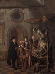 Bezoekers in het atelier van een beeldhouwer