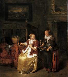 Interieur met een jonge vrouw en een dienstmeid met een schaal met vis