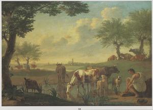 Landschap met koeien bij een drenkplaats