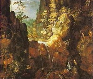 Bebost rotslandschap met herten en een ooievaar bij een waterval