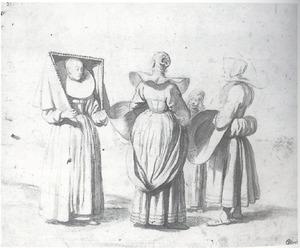 Drie vrouwen en een meisje in Munsters costuum