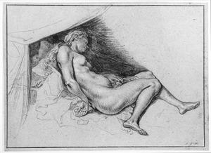 Naakte vrouw liggend op een bed