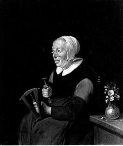 Oude vrouw met een haspel en spoel