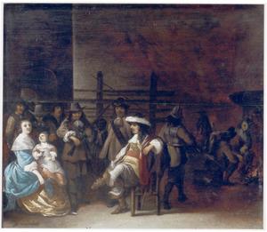 Wachtlokaal met een rijk gekleed paar met kind