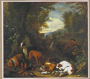 Jager en honden rusten bij buit van haas en gevogelte