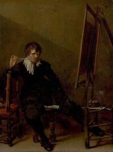 Jonge schilder rokend voor zijn ezel