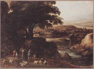 Weids landschap met herders bij een bosrand