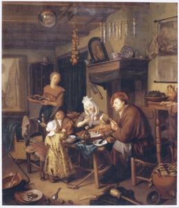 Interieur met een schilder aan de maaltijd met zijn familie