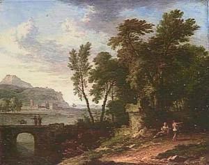Heuvelachtig riviergezicht met vrouw bij ruïne