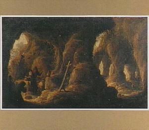 Interieur van een grot met de verzoeking van de H. Antonius