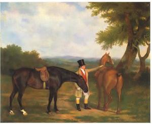 Twee jachtpaarden met een verzorger