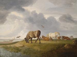 Kustlandschap met grazende koeien en paarden