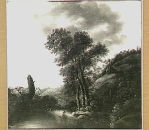 Heuvellandschap met een jager bij een grote boom