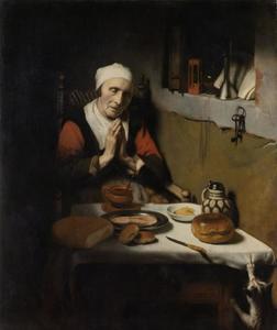 Oude vrouw tijdens het gebed aan tafel