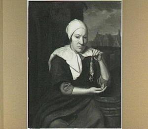Vrouw met een haring in haar hand