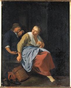 Een jonge vrouw en een slapende jonge man