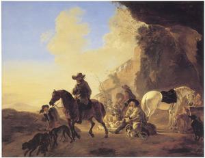 Zuidelijk landschap met halthoudende reizigers bij een drinkbak in een grot