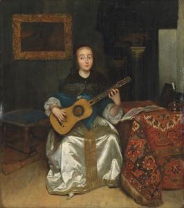 Jonge vrouw die gitaar speelt