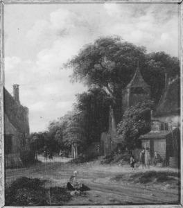 Landschap met weg door een dorp
