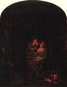 Arts met patiënt bij kaarslicht