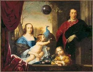 Portret van een onbekende familie met glazen bol