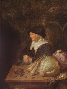 Zittende vrouw bij een tafel met groente