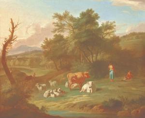 Een bebost landschap met herders bij hun rustende vee