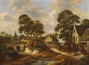 Gezicht op een dorp met figuren voor een herberg