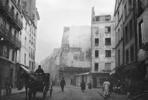 Straat met paardenkoets te Parijs