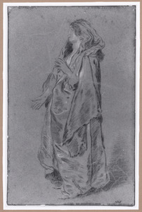 Staande vrouw in een mantel