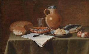 Stilleven van brood, schotels met vis, boter, een tinnen beker en een kruik