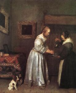 Interieur met een jonge vrouw die haar handen wast