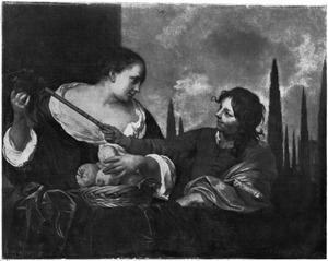 Jongen gebaart met een fluit naar een vogel op de hand van een jonge vrouw