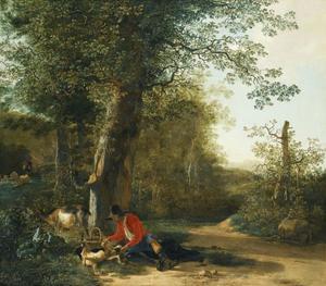 Rustende boer speelt met zijn hond aan rand van bos
