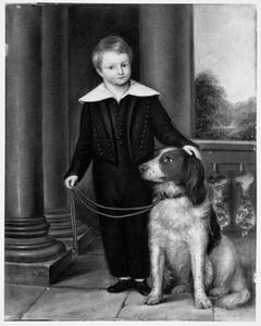 Portret van een jongen met een aangelijnde hond
