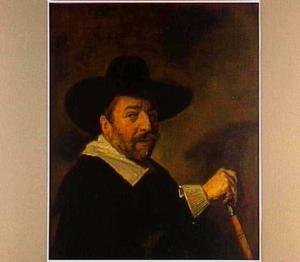 Portret van een man met een stok