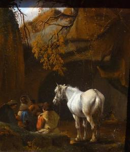 Rustende reizigers met een paard bij een grotingang