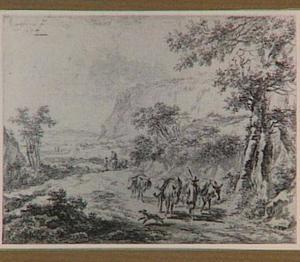 Berglandschap met een man en drie ezels