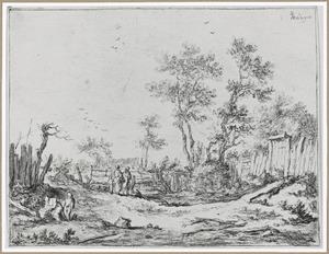 Landschap met beek en schutting van planken