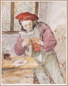 Lezende jongeman aan een tafel