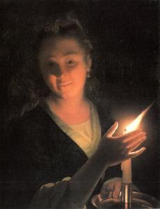 Jonge vrouw met brandende kaars