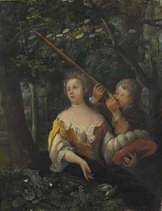 Meisje en jongen met een erwten-schieter