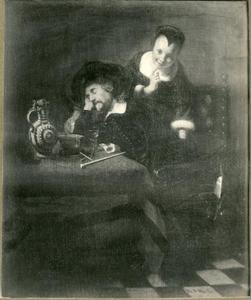 Slapende man wordt bestolen door een vrouw