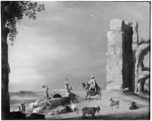 Landschap met ruïnes en figuren