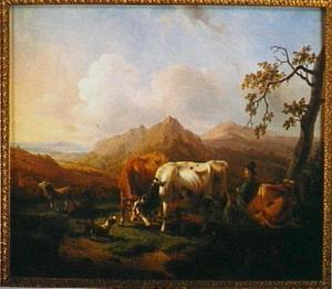 Herder met vee in een bergachtig landschap